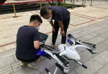 Workers adjust an unmanned aerial vehicle to be used for delivering supplies to Guanggang new town, Guangzhou, south China's Guangdong province, June 5. (Photo/Official Weibo account of Guangzhou cyberspace administration)