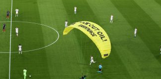 15 June 2021, Bavaria, Munich: A Greenpeace activist lands on the pitch before the start of the UEFAEURO2020 Group Fsoccer match between France and Germany at the Allianz Arena. Photo: Christian Charisius/dpa