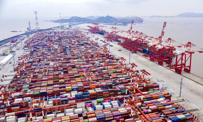 Large container vessels are docked at an automated terminal of Shanghai's Yangshan Deep Water Port, May 21, 2021. (Photo by Ji Haixin/People's Daily Online)
