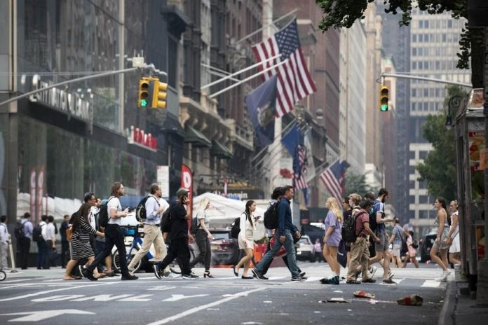 People walk on a street in New York, the United States, on July 20, 2021. (Xinhua/Wang Ying)