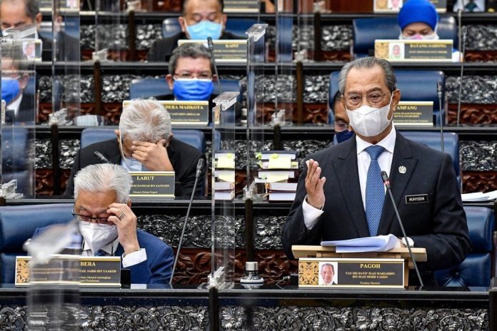 Malaysia's Prime Minister Muhyiddin Yassin speaks during a session of the lower house of parliament on Monday. The king has sharply criticised his government. Photo: Reuters