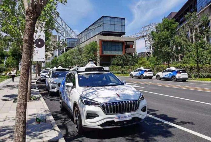 Photo shows autonomous vehicles of Chinese tech giant Baidu parked at the New Shougang High-end Industry Comprehensive Service Park in Beijing. (Photo by Du Yifei/People's Daily)