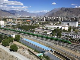 Photo taken on June 25 shows the first Fuxing bullet train from Lhasa, capital of southwest China's Tibet autonomous region, to Nyingchi city of the region, running on the railway linking the two cities. (Photo by Jiao Hongtao/People's Daily Online)