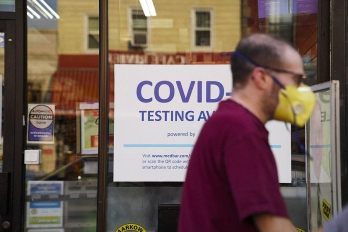 A pedestrian walks past a COVID-19 testing billboard in New York, the United States, July 26, 2021. (Xinhua/Wang Ying)