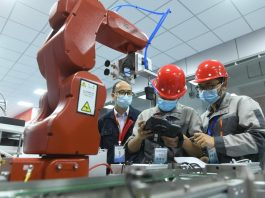 Photo taken on Oct. 21, 2020 shows contestants performing tasks related to the application of smart sensor technologies in a qualification trial of China's national artificial intelligence technical skills competition at a competition site in east China's Anhui province. (Photo by Wang Biao/People's Daily Online)