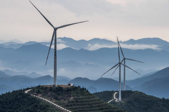 Photo taken on July 10, 2021, shows a wind farm in Panfeng township, Pan'an county, Jinhua city, east China's Zhejiang province. (Photo by Chen Yueming/People's Daily Online)