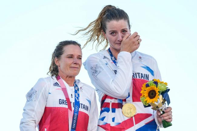 Hannah Mills and Eilidh McIntyre celebrate the 470 women's gold medal
