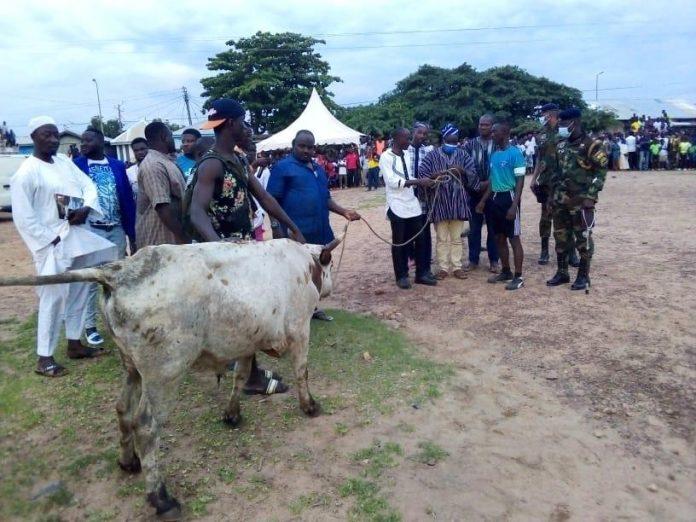 Lt Col Kwesi Gyimah receiving the cow from Naa Kardri Ibrahim, Wa Naa's Spokesperson