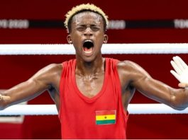 Samuel Takyi (red) of Ghana celebrates after the men's feather (52-57kg) quarterfinal match of boxing at the Tokyo 2020 Olympic Games in Tokyo, Japan, Aug. 1, 2021. (Xinhua/Ou Dongqu)