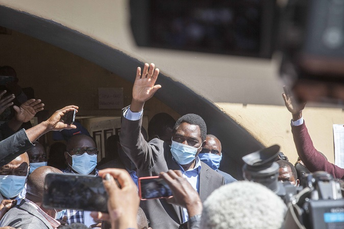 Hakainde Hichilema waves at his supporters after casting a vote at a polling station in Lusaka, Zambia, Aug. 12, 2021. Zambia's opposition leader Hakainde Hichilema has emerged as the winner in the Aug. 12 presidential election, beating incumbent President Edgar Lungu. Hichilema managed to pass the 50 percent-plus-one requirement for a presidential winner with 2,810,757 of the votes while Lungu got 1,814,201. (Photo by Martin Mbangweta/Xinhua)