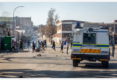 Protestors are dispersed by police during a protest against the incarceration of former president Jacob Zuma in Johannesburg, South Africa, July 11, 2021. The South African police said on Sunday that they have arrested 62 people in KwaZulu-Natal and Gauteng Province as people protested against the incarceration of former president Jacob Zuma. TO GO WITH