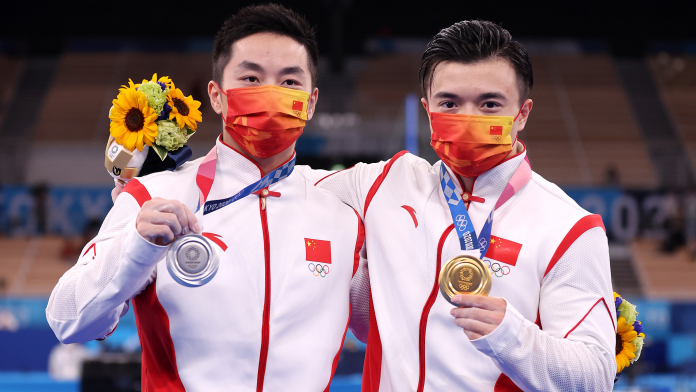 Liu Yang (R) and You Hao of China celebrate after the men's rings final at the Tokyo Olympics in Tokyo, Japan, August 2, 2021. /CFP