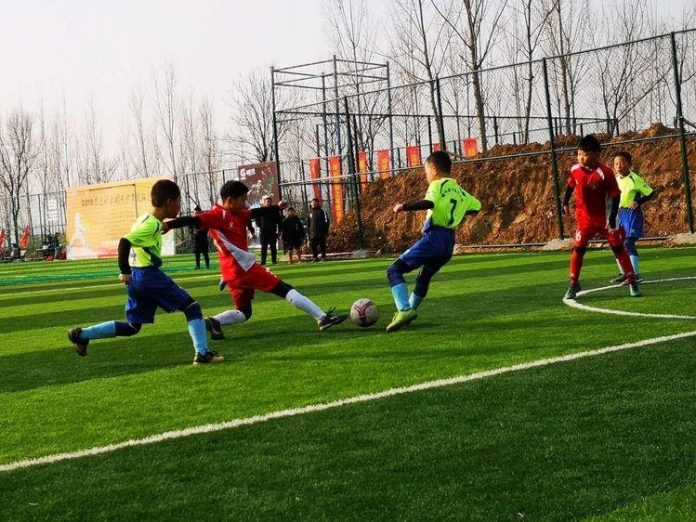 A football team of Zhonglianchuan Primary School in northwest China's Gansu province takes part in a contest in central China's Henan province, Jan. 2019. (Photo/Zhonglianchuan Primary School)
