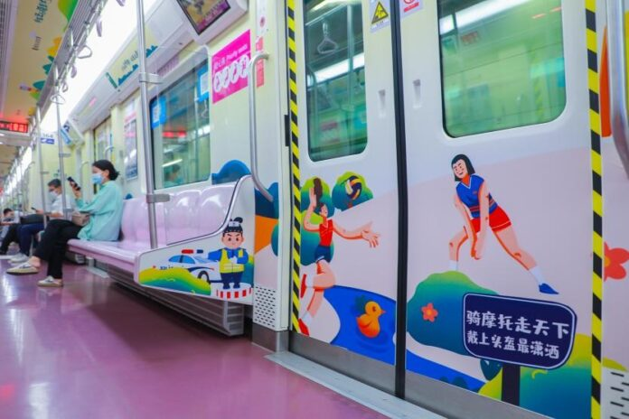 Passengers take a subway train featuring the 14th National Games in Xi'an, northwest China's Shaanxi province, August 5, 2021. (Photo by Shen Li/People's Daily Online)