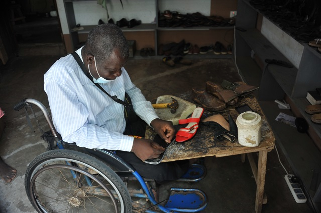 Joseph Odey Mensah makes shoes at his workshop in Accra, Ghana, on Sept. 13, 2021. In a country where people with disabilities mostly tend to beg for alms on the streets to survive, Joseph Odey Mensah changed the narrative to become an entrepreneur and determined to make a huge mark in Ghana's local shoemaking industry. (Xinhua/Seth) TO GO WITH Feature: Ghanaian man with disability blazing trails in shoemaking