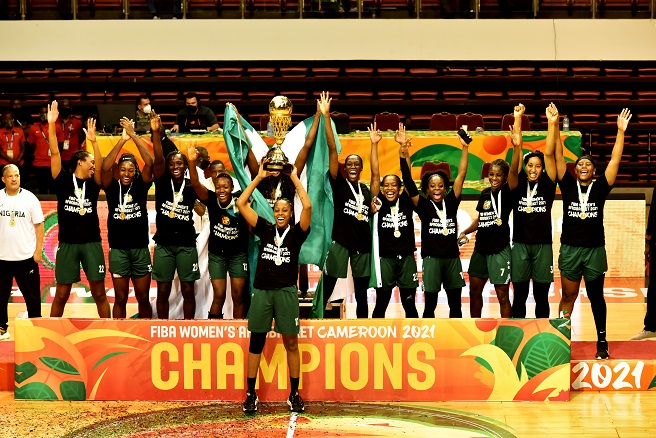 Nigerian players celebrate victory at FIBA Women's AfroBasket 2021 Champions in Yaounde, capital of Cameroon, Sept. 26, 2021. Nigeria on Sunday beat Mali 70-59 at the FIBA Women's AfroBasket finals in Yaounde, Cameroon, to extend their supremacy on the continent. (Xinhua/Kepseu)