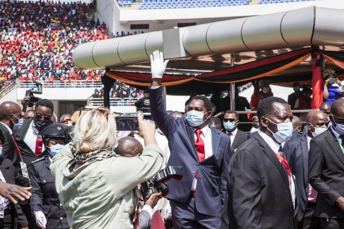 Hakainde Hichilema waves to his supporters during the inauguration ceremony at the National Heroes Stadium in Lusaka, Zambia, on Aug. 24, 2021. Hundreds of dignitaries and thousands of ordinary citizens on Tuesday thronged the National Heroes Stadium in Lusaka, the Zambian capital, to witness the inauguration of the country's new President Hakainde Hichilema. (Photo by Martin Mbangweta/Xinhua)