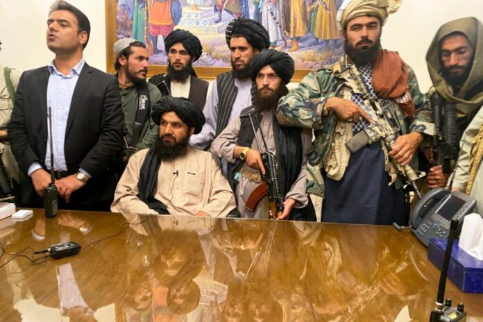 Taliban fighters take control of Afghan presidential palace after the Afghan President Ashraf Ghani fled the country, in Kabul, Afghanistan, Sunday, Aug. 15, 2021. (AP Photo/Zabi Karimi)